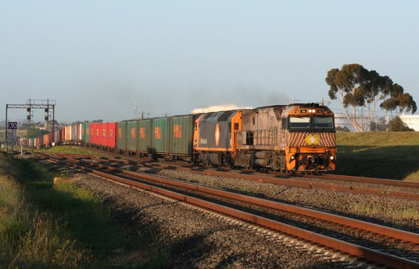 Indigenous liveried NR52 and AN8 eastbound at Corio