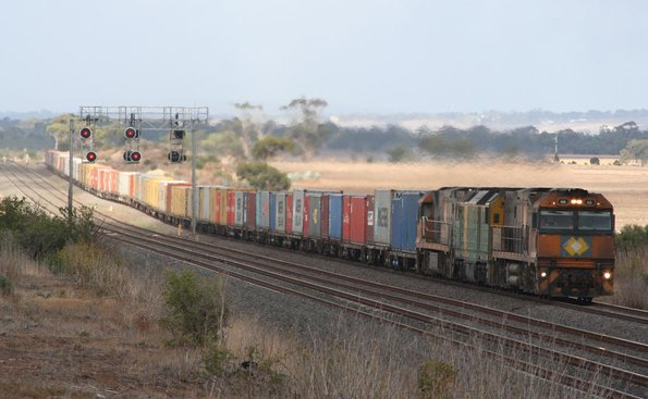 Just missing out on the sunshine,  Melbourne bound NR66, DL43 and NR98 outside Little River