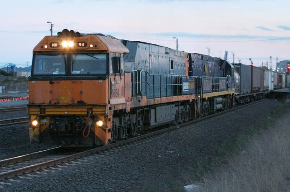 NR94 and Indian Pacific liveried NR25 Melbourne bound at North Shore, Geelong