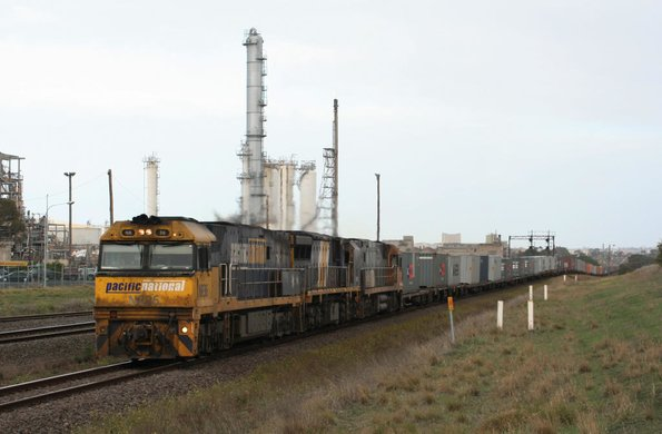A grubby PN liveried NR36 leads XRB56 and NR20 eastbound on the Patricks train at Corio