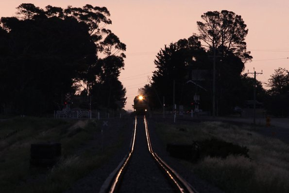 An approaching headlight after sunset at Moorabool