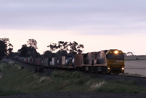 PN liveried NR37 and vanilla NR42 lead PM6 eastbound through Moorabool