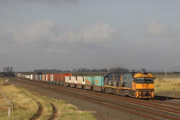 Finally, some sun at the right time! NR89 leads Indian Pacific liveried NR27 on the up at Manor Loop