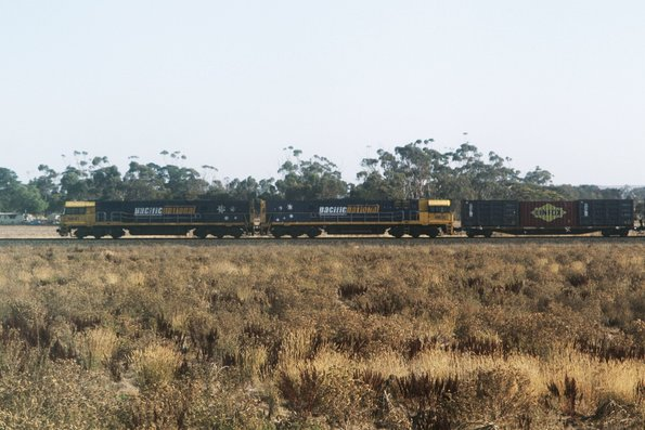 NR41 and NR11 lead an up Pacific National intermodal freight outside Gheringhap