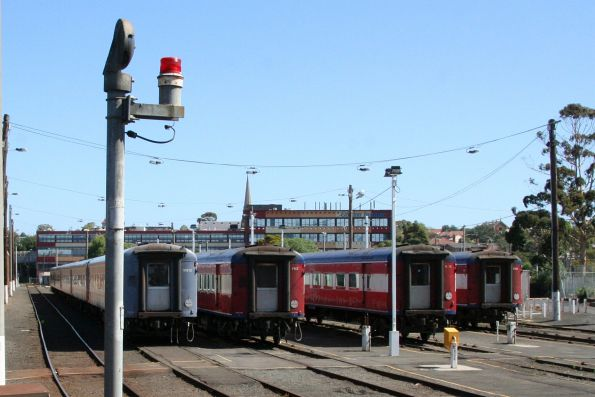 Carriage sets VN12, FN2, N16 and FN8 stabled in the yards at Geelong