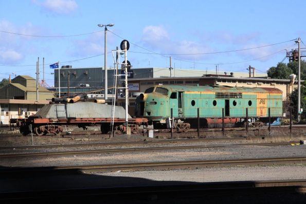 The shell of GM25 sits on transfer bogies outside the Gemco rail shed at South Dynon