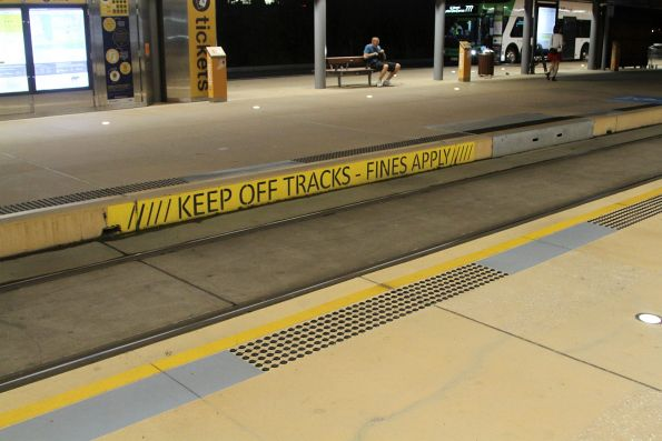 'Keep off the tracks' sign along the platform at Broadbeach South