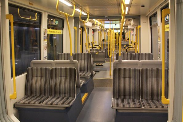 Paired seats in the tram module above the wheels