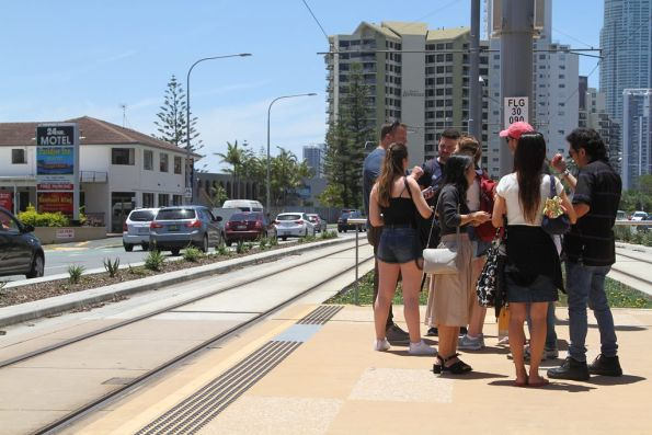 Tourists without tickets being questioned by plain clothes ticket inspectors