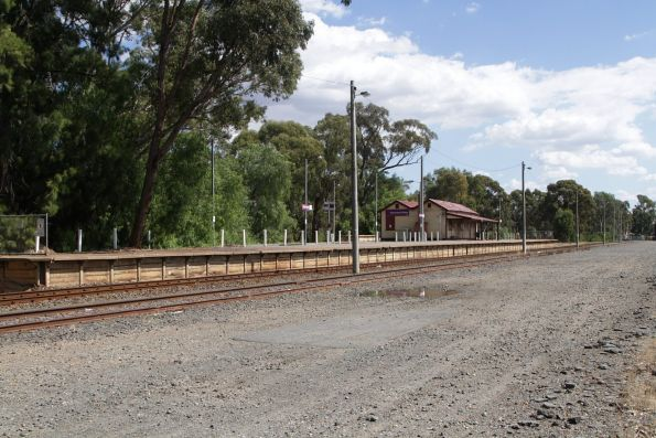 Station platform and empty freight terminal at Mooroopna