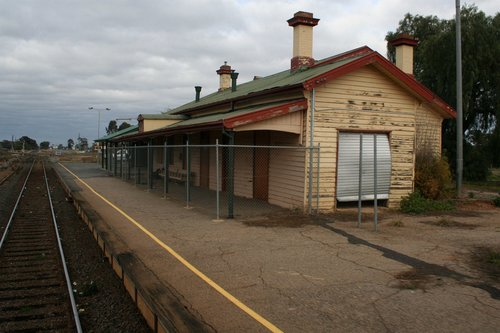 Boarded up timber station building at Murchison East