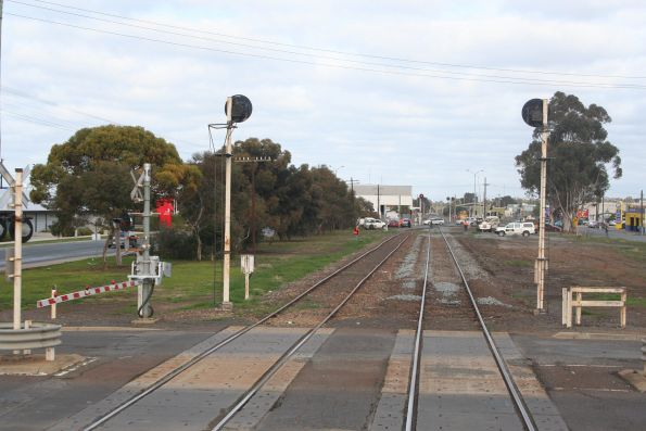 Two tracks cross the Fryers Street level crossing in Shepparton