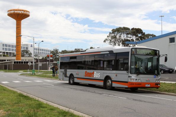 Bus stop for the 901 Smartbus at Melbourne Airport: Invicta bus #8901 rego 2248AO