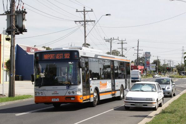 Grenda #8381 rego 7654AO with a route 902 Smartbus service passes the route 59 tram terminus at Airport West