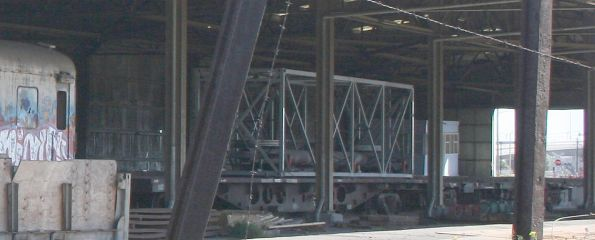 Experimental crew car container on a flat wagon in storage near the Melbourne Steel Terminal