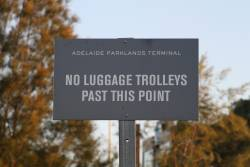 'No luggage trolleys past this point' notice at Adelaide Parklands Terminal