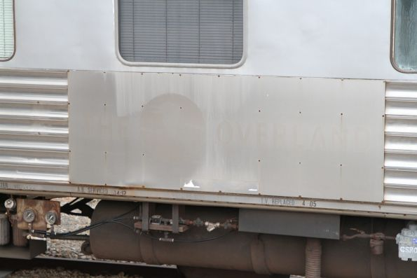 Faded early 2000s 'The Overland' kookaburra logo on the side of sleeping carriage JTB2 'Yankai' at Adelaide Parklands Terminal