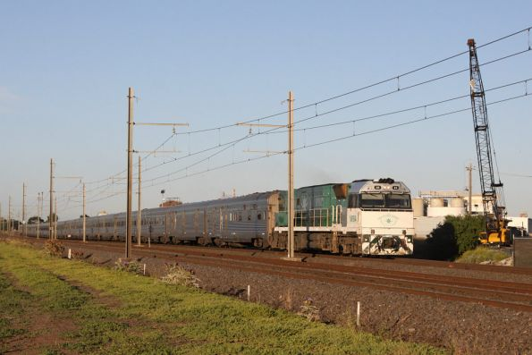 NR84 leads the train into Melbourne near Paisley