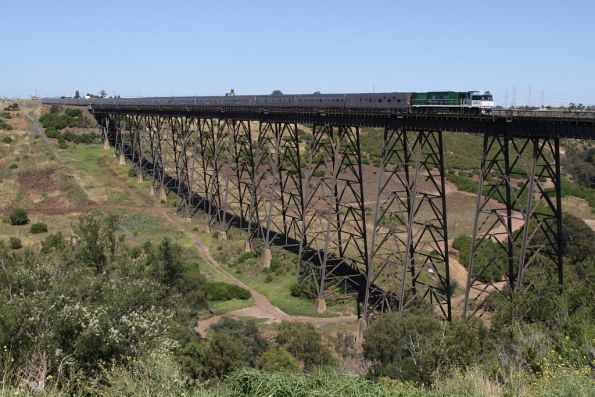 NR84 leads the train north over the Maribyrnong River Viaduct