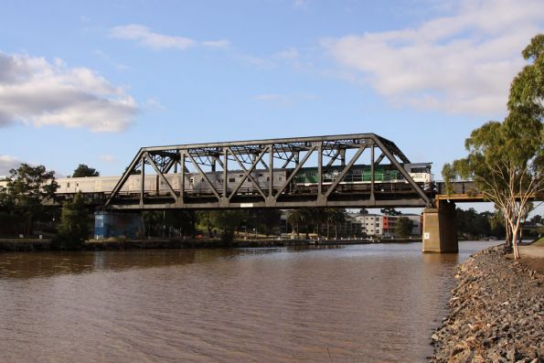 Bound for a short pitstop at Southern Cross, NR85 leads across the Maribyrnong River