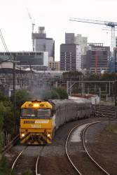 NR51 leads the empty cars over the flyover to Dynon