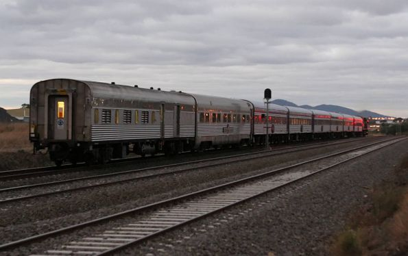 The Overland Melbourne bound at North Shore, a Ghan sitting car as the second last vehicle