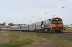 NR42 on the Adelaide bound Overland at North Geelong, with a PHN power van and HG baggage van in the consist