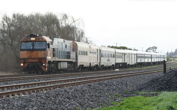 NR42 leads The Overland into North Shore, with two Southern Spirit carriages attached on transfer