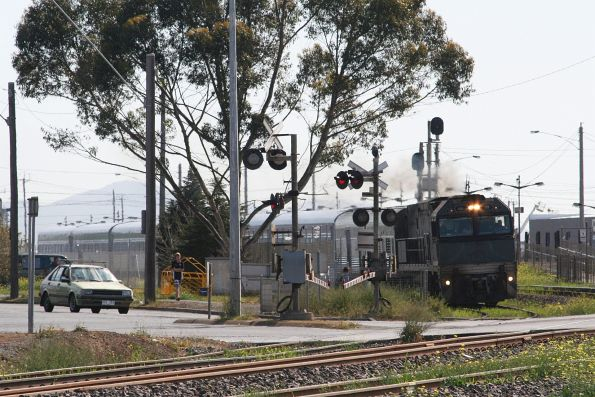 Steelink liveried NR59 leads The Overland westbound out of North Shore after a station stop