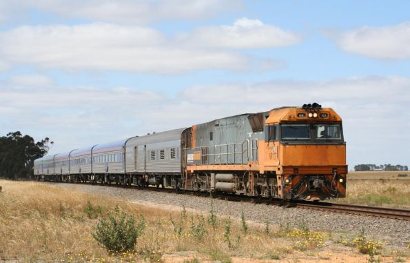 NR107 leads the Overland westbound at Miniera