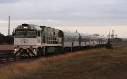Southern Spirit liveried NR84 leads the eastbound Overland out of Corio