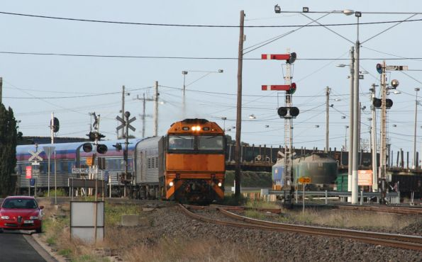 NR111 leads the Overland out of North Geelong C