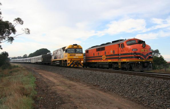 NR16 running westbound through Inverleigh passes GM42 in the siding stabled on a sleeper train