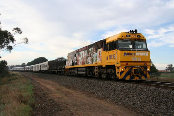 NR16 in rail safety livery running westbound through Inverleigh