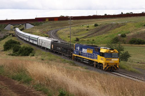 NR81 leads The Overland out of Bell Post Hill past the Geelong Ring Road, power van PCO4 in the consist