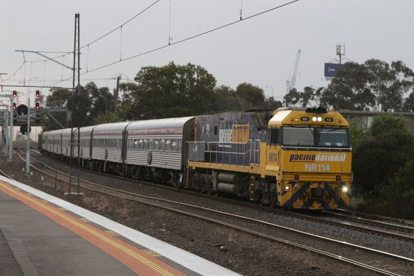 NR114 leads a normal length Overland into Melbourne at Middle Footscray