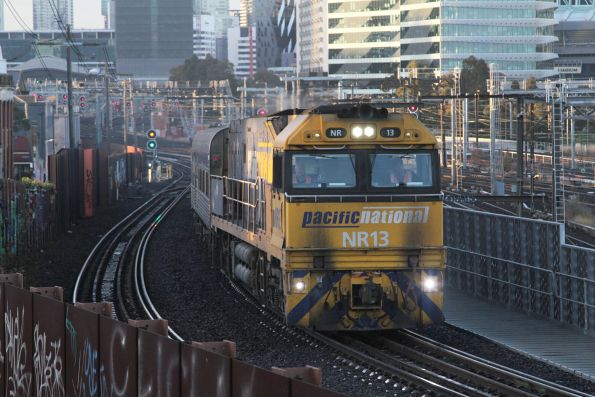 NR13 leads the westbound Overland over the North Melbourne flyover