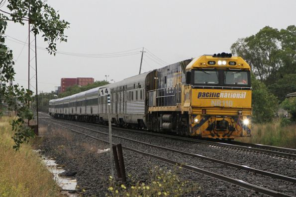 NR110 leads The Overland with 10 cars westbound at Brooklyn
