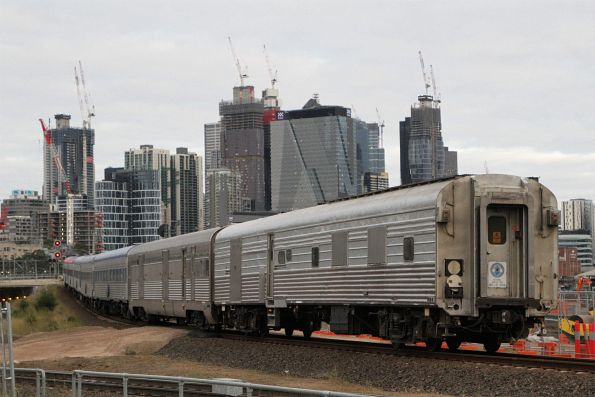NR67 leads The Overland over the North Melbourne flyover towards Southern Cross Station
