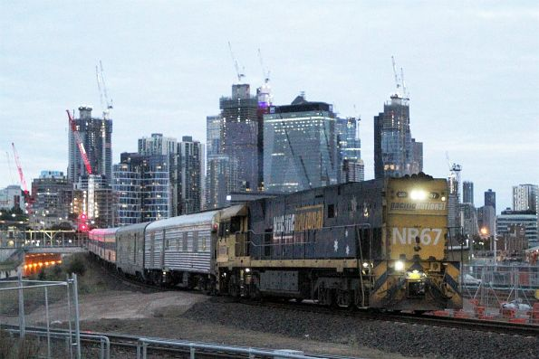 NR67 leads The Overland empty car move off the North Melbourne flyover bound for South Dynon