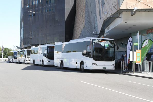 Moreland Bus coach #21 BS04PK leads the queue of Westall rail replacement services at Federation Square