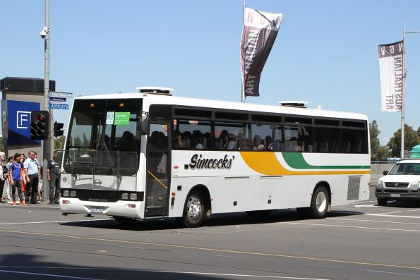 Simcocks' non-air conditioned coach #18 0218AO departs Federation Square with a Westall rail replacement service