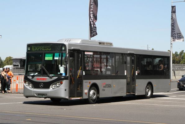 Sandhu Bus Lines #1704 BS00PQ departs Federation Square with a Westall rail replacement service