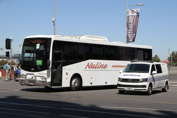 Nuline Charter coach #11 7411AO departs Federation Square with a Westall rail replacement service