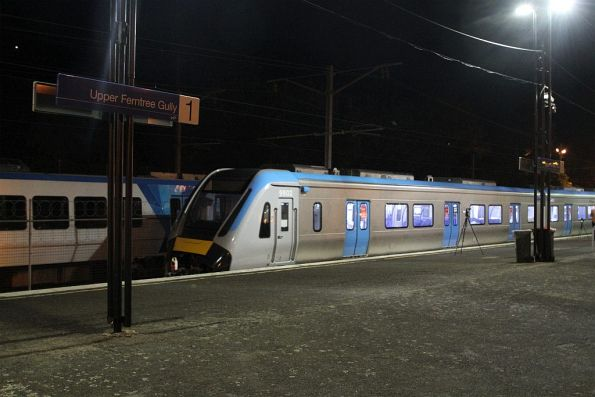 HCMT set rolls through the platform at Upper Ferntree Gully