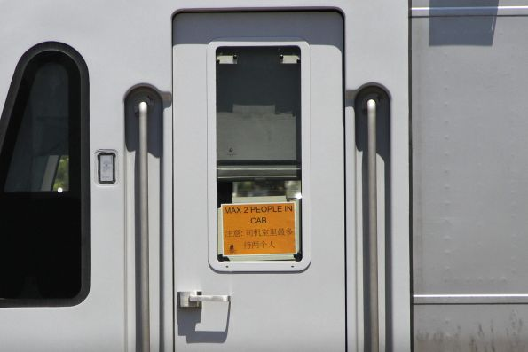 'Max 2 people in cab' signage on the HCMT cab doors