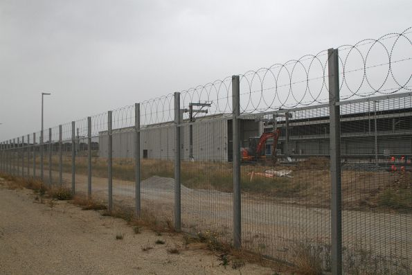 Big steel fence surrounds the depot
