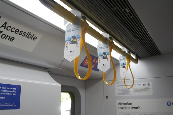 Strap hangers along the carriage