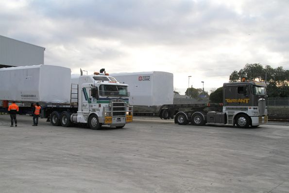 Trucks from 'Overdimensional Lift & Shift' and 'Tarrant Logistics' have delivered the two carriage bodies