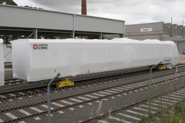 Plastic wrapped HCMT 'DMp' motor cab carriage outside the shed at Newport